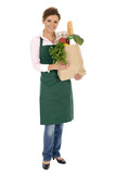 Woman in apron holding grocery bag poster