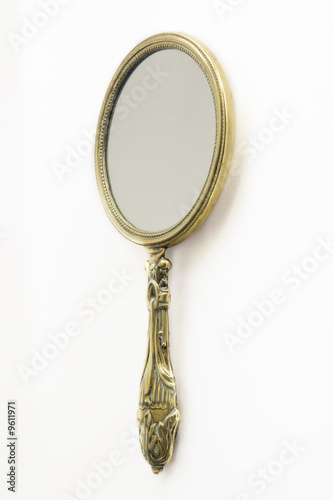 Ornate Antique Art Deco brass hand-mirror. Isolated on white - 9611971