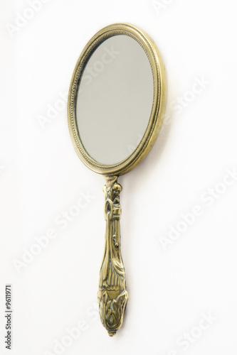 Leinwanddruck Bild Ornate Antique Art Deco brass hand-mirror. Isolated on white