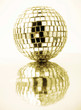 gold disco ball with reflection