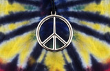 Tue dye shirt with peace sign necklace poster