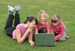 young woman and two girls with laptop