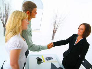professional caucasian couple with broker in purchasing a house