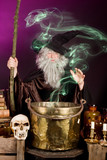 Green ghost leaving the cooking pot of a halloween sorcerer