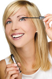 young blond woman applying mascara close up poster