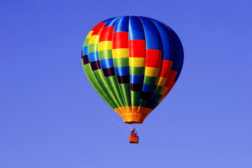 Colorful hot air balloon against a bright blue sky