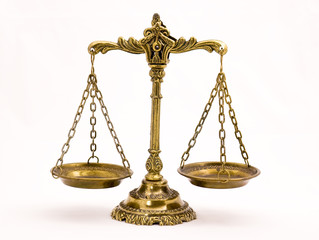 A photo of the scales of justice with a balance theme overlay