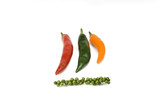 Fresh red, yellow and green chilis and unripe Black pepper poster