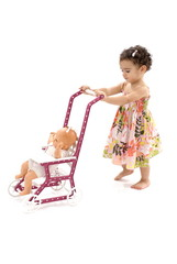 Little Child taking her doll for walking .