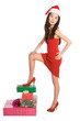 Asian female posing on heap of Christmas gift boxes