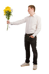 The man in a white shirt with a bouquet of yellow flowers