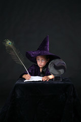 wizard child in purple velvet