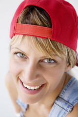 closeup portrait of young woman with baseball cap
