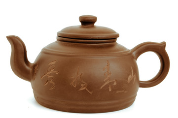 classic chinese teapot of brown clay isolated on white