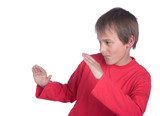 a boy on white background pretending to do martial arts poster