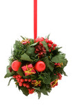 Christmas ornament, red and gold elements on green foliage ball