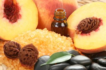 peaches bath with bath salt essential oil and fresh fruits