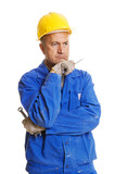 thoughtful workman with tools. isolated on white poster