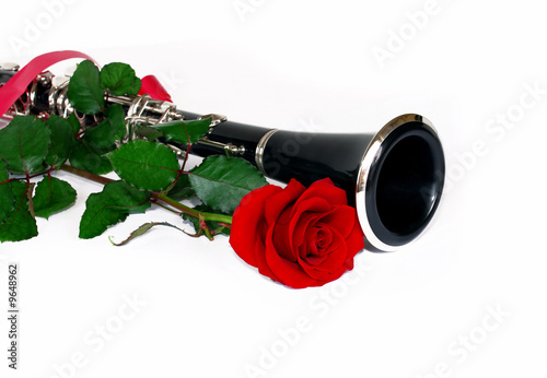 red rose and clarinet composition isolated