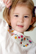 portrait of cute two year old blond girl