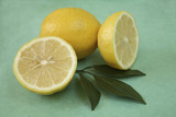 Whole lemon with two cut lemon halves