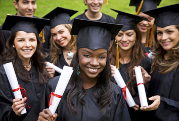 women«s group graduation holding their diplomas