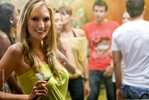 woman happy and smiling in a bar or a nightclub