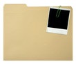 Blank instant print clipped to file folder