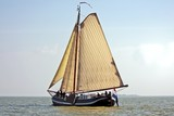 Traditional sailboat on the IJsselmeer in the Netherlands