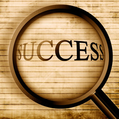 Success seen through a magnifier on old office paper