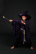 wizard boy in purple velvet hat and robe