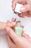 applying manicure: moisturizing the nails and skin poster