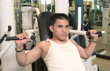 man exercise in fitness center