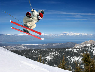 A young man jumping high at Lake Tahoe resort