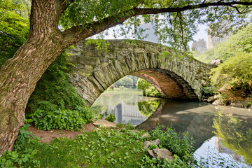 A stone bridge, Gapstow Bridge, in Central Park, NY.