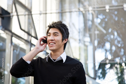 A casual asian businessman talking on the phone - 9662126