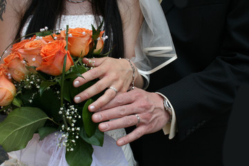 nice orange roses from the wedding and hands