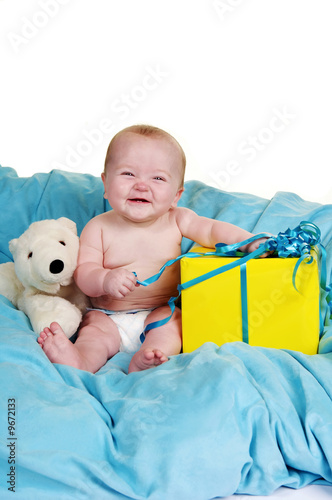 poster of Baby on a fluffy blue blanket with a big smile
