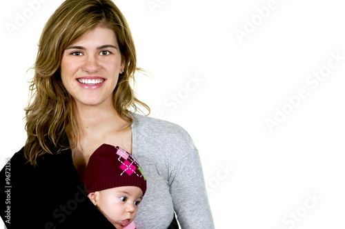 Mother with her baby girl in a sling