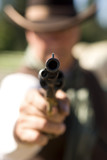 Cowboy aiming gun, focus only on gunpoint poster