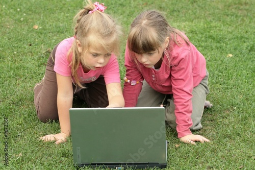 two girls with laptop