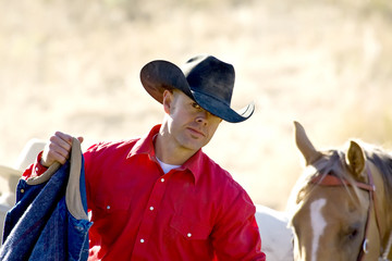 Cowboy and his horse out working
