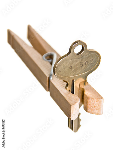 Mortgage Crises Concept: House Key Pinched by Clothespin