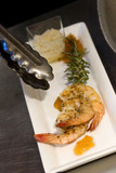 plate of shrimp and rosemary with apricot marmalade garnish poster