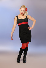 cute burlesque blond girl in black dress & red stockings