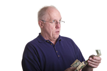 An older bald guy counting out money