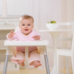Hungry baby in highchair waiting to be fed