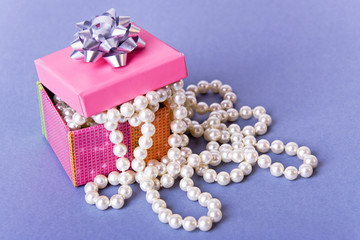 little pink box with white pearl beads