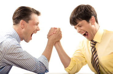 Portrait of emotional men screaming during arm wrestling