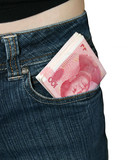 Chinese Yuan Notes in a womans jeans pocket poster